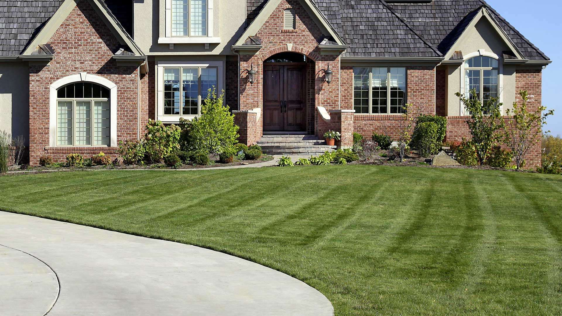 Lawn mowing and maintenance services by Green Pastures Lawn Maintenance LLC at a home in Franklinton, LA.
